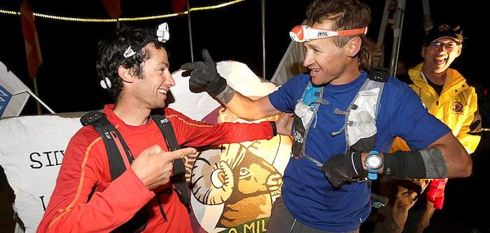 Kilian Jornet and Jason Schlarb winning the Hardrock 100 race together, both using Petzl headlamps.