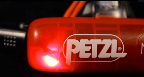 Petzl Nao+ Plus battery compartment red light activated.